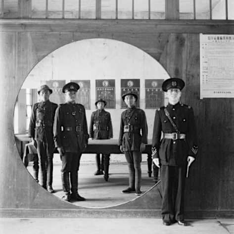 The Chinese Police Force; the Assistant Chief of Police and his staff grouped in a circular doorway at headquarters in Chengtu